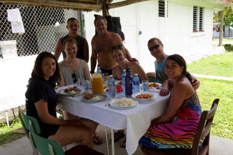 Volunteer and staff eating together