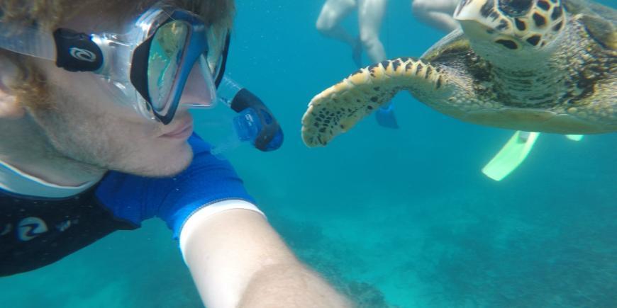 Intern Alex and hawksbill turtle in Mauritius