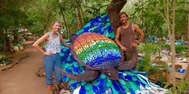 Volunteers by sea turtle sculpture