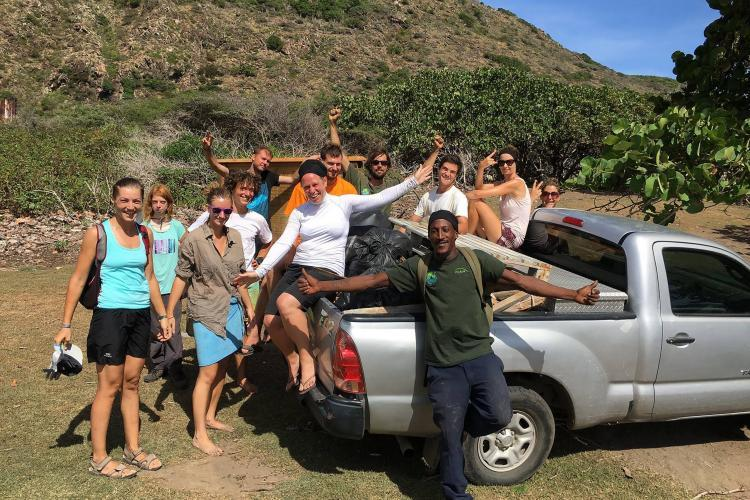 Conservation Volunteers with truck in Caribbean