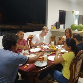 Volunteer eating with homestay family