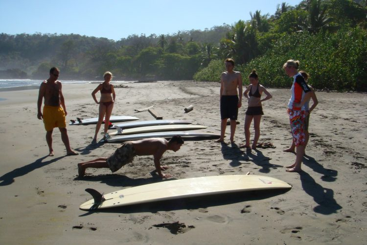 Volunteers having surfing lesson in Costa Rica