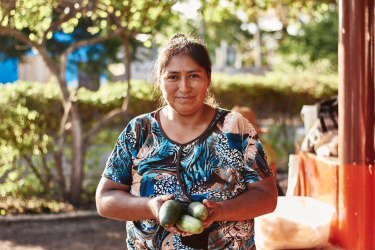 Galapagos woman holding cucumbers