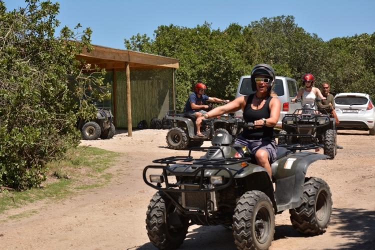 Volunteers riding a quad bike in South Africa