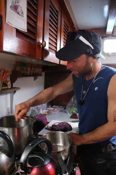 Volunteer preparing meal on board in Hebrides