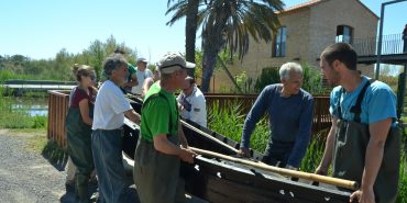 Volunteers carrying a boat in Valencia