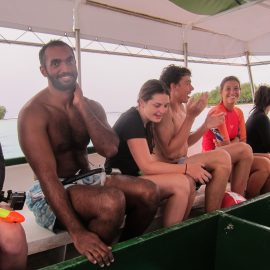 Volunteers laughing on boat in Mauritius