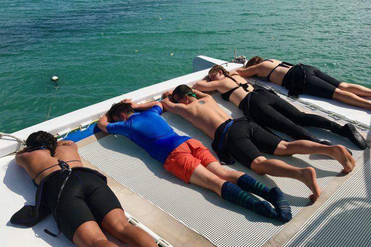 Volunteers sunbathing in Carriacou