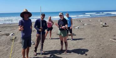 Volunteers with Olive Ridley turtle in Ostional