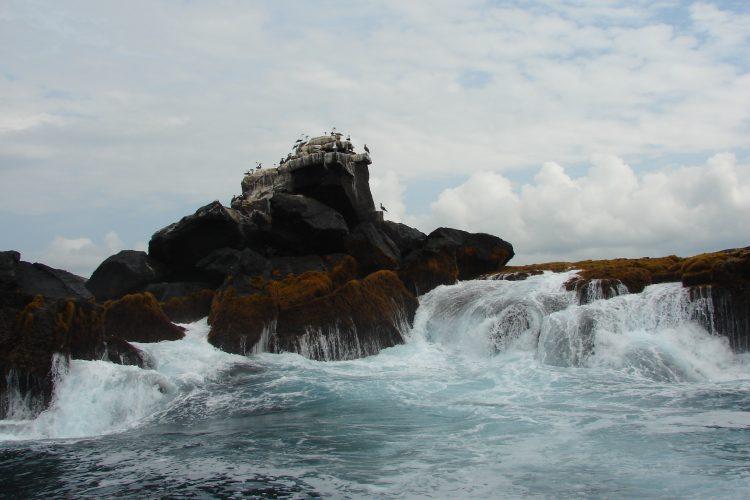 Waves crashing Galapagos islands