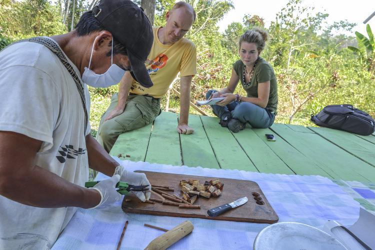 Medicinal Plants volunteer observing preparation