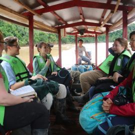 Student volunteers travelling upriver