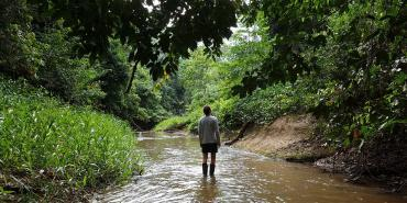 Volunteer in amazon rainforest river