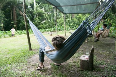 Volunteer relaxing in hammock