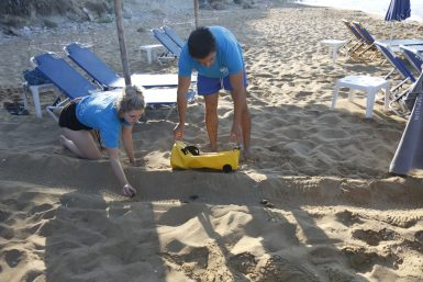Volunteers on beach in Greece