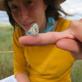 Volunteer holding butterfly