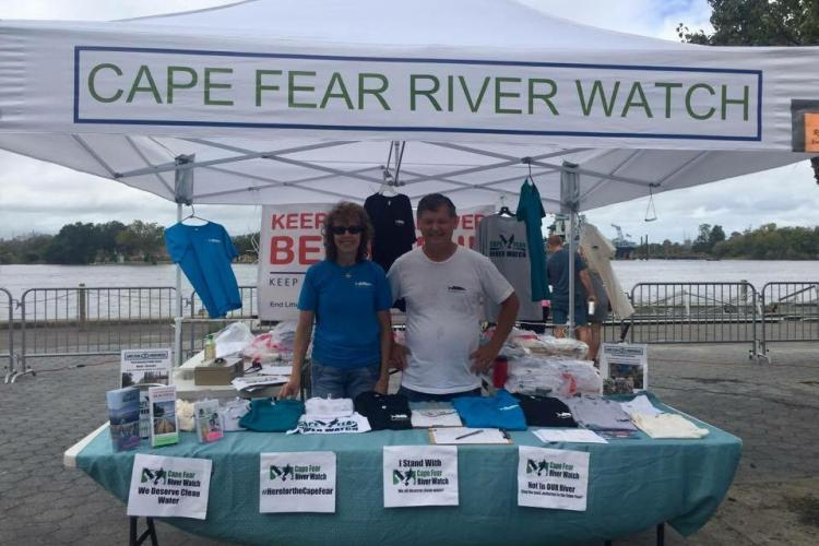 Cape fear river watch visitors stand