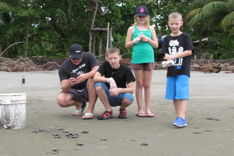 Children with sea turtles in Costa Rica