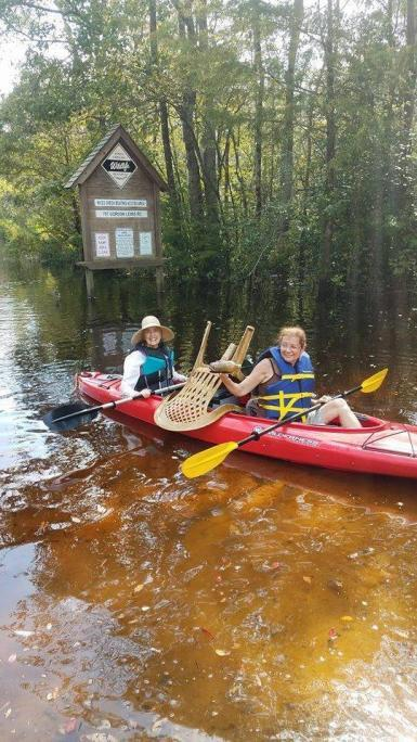 Conservation volunteers in canoe Cape Fear River