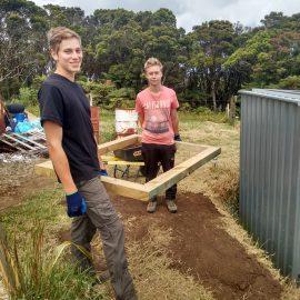 Construction volunteers in nature sanctuary New Zealand