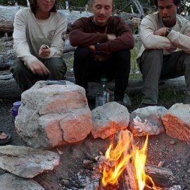 Volunteers cooking by fire in California