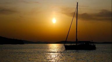 Sailing boat sunset in Croatia