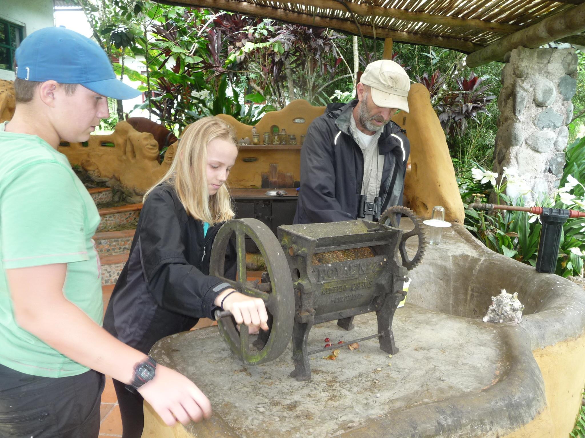 Volunteers grinding coffee in Ecuador forest