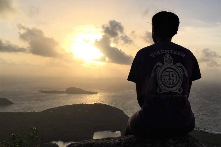 Volunteer at sunset in Grenada