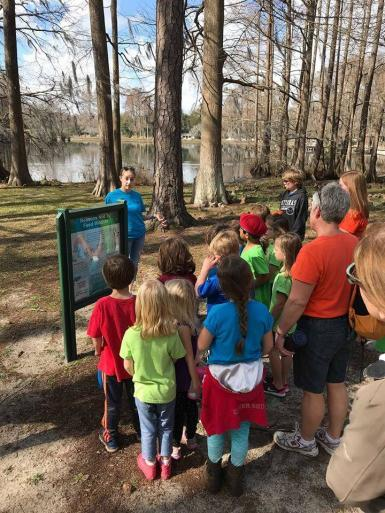 Intern talking with children about river conservation