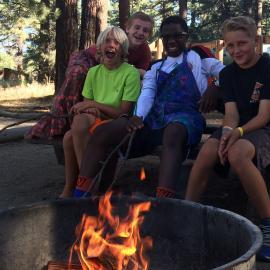 Interns having campfire at Galena