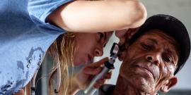Medical volunteer giving hearing check in Nepal
