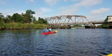 Interns canoeing on Cape Fear river