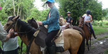 Volunteer on horseback Ecuador cloud forest