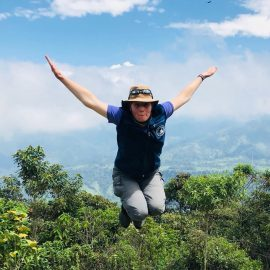 Volunteer jumping in Ecuador cloud forest