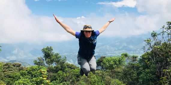 Volunteer jumping in Ecuador cloud forest