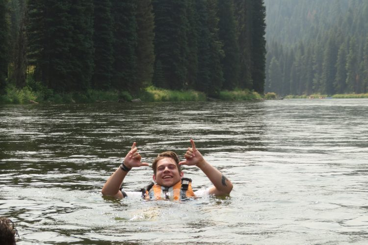 Volunteer swimming in river