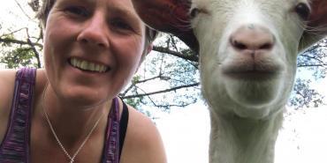 Volunteer with goat in Ecuador