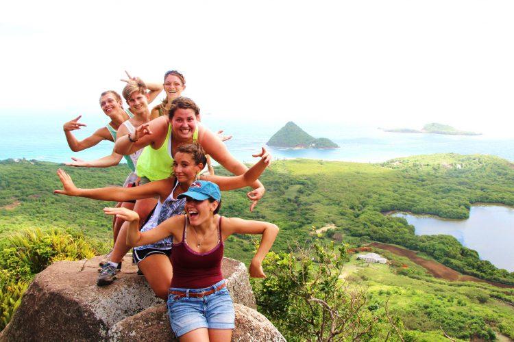 Volunteers at Welcome stone in Grenada