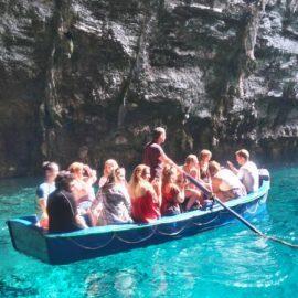 Volunteers boating on Melissani lake Argostoli