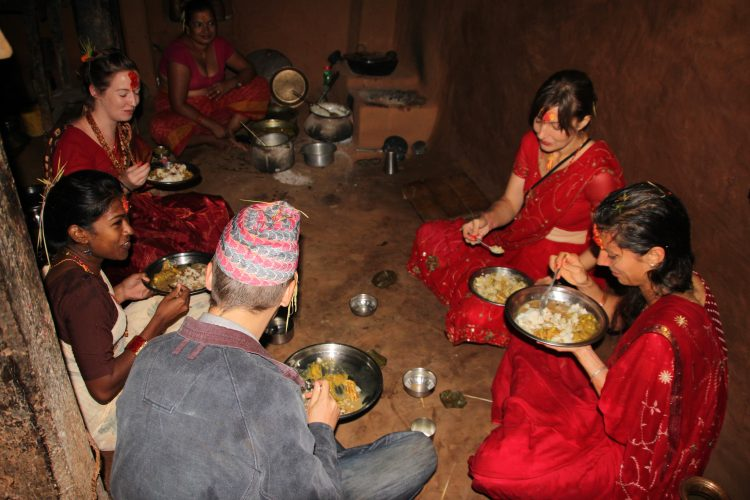 Volunteers eating a meal in Nepal