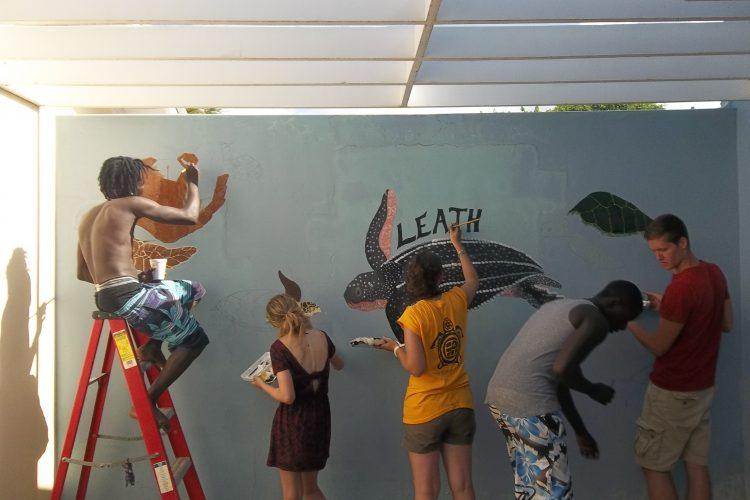 Volunteers painting turtles in Grenada
