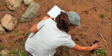 Checking animal tracks at Kariega Game Reserve