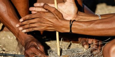Learning traditional fire lighting by San Bushmen in Namibia