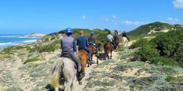 Volunteers horse riding at Kenton on Sea in free time