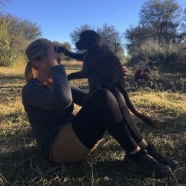 Volunteer Sarah in Namibia with baboon
