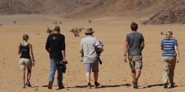 Volunteers walking in the Namib desert