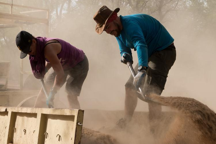 Volunteers digging in the mud in Namibia