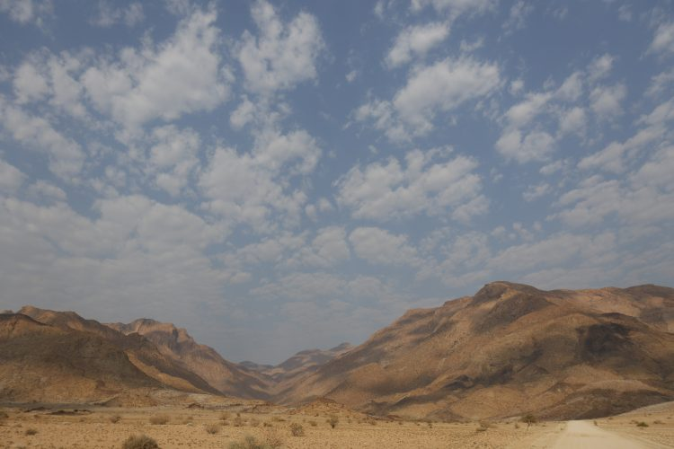 Open road driving to the Brandberg mountains in Namibia