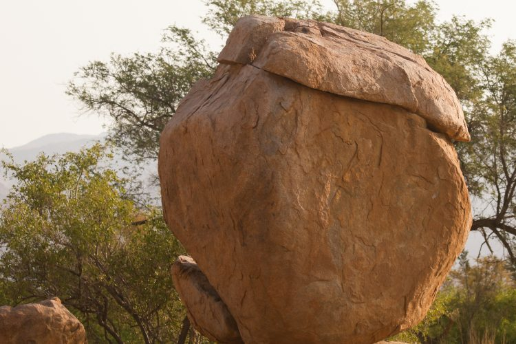 Funky face in red stone in Namibia