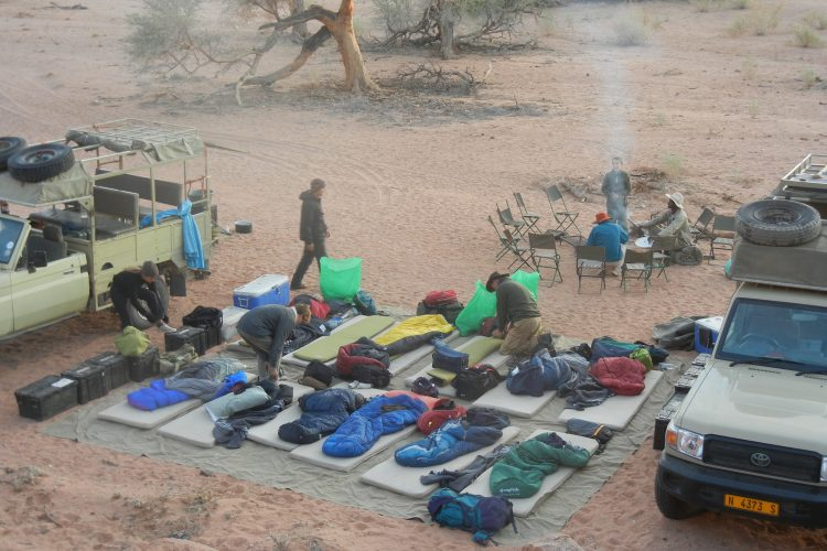 Family volunteering group sleeping out under stars in Namibia